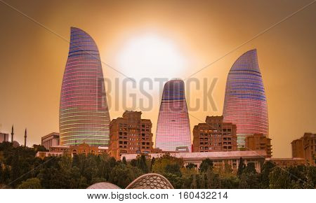 BAKU, AZERBAIJAN -OCT 3, 2016: Flame Towers skyscraper on sunset in Baku, Oct 3, 2016,  Azerbaijan. The Flame Towers is the tallest skyscraper in Baku, with a height of 190 m.
