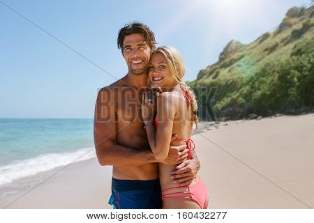 Loving Couple Embracing On The Beach