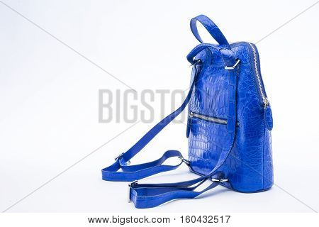 backpack crocodile skin with blue color isolated on white background