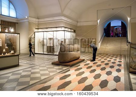 Saint-Petersburg, Russia, December 1, 2016: People look at the exhibits in The Room of Ancient Egypt in The State Hermitage Museum
