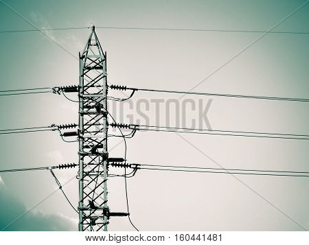 Duo tone color / High voltage tower and cable line in the sky