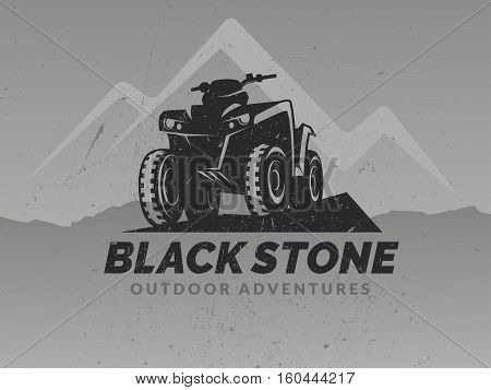 ATV logo on grunge grey backgrounds with mountains.