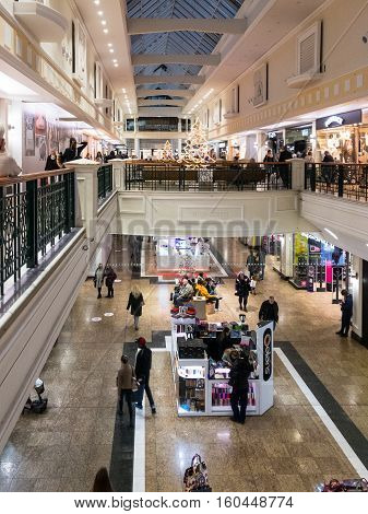 SHEFFIELD ENGLAND - NOVEMBER 29: Sheffield Meadowhall shopping mall interior full of people Christmas shopping. In Sheffield South Yorkshire England. On 29th November 2016.