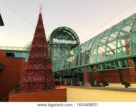 SHEFFIELD ENGLAND - NOVEMBER 29: Sheffield Meadowhall centre exterior with Christmas tree lit in red. In Sheffield South Yorkshire England. On 29th November 2016.