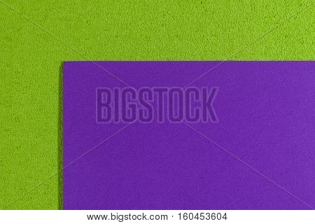 Eva foam ethylene vinyl acetate smooth purple surface on apple green sponge plush background
