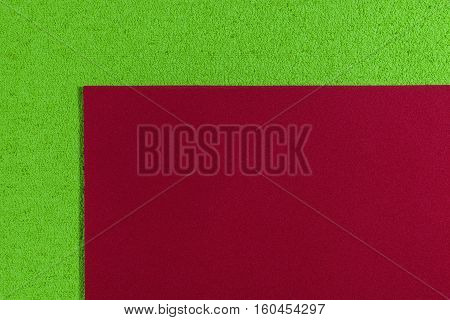 Eva foam ethylene vinyl acetate smooth red surface on apple green sponge plush background