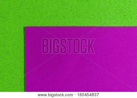 Eva foam ethylene vinyl acetate smooth pink surface on apple green sponge plush background