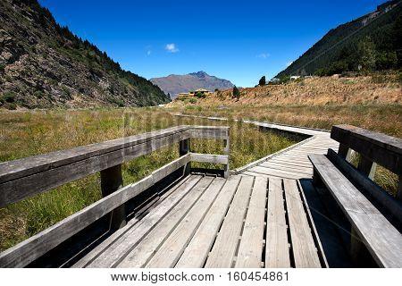 Long wooden bridge in queenstown New Zealand