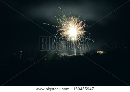 Brightly Colorful Explosive Fireworks Light Up The Night Sky At New Year's Eve Celebrations. Happy N