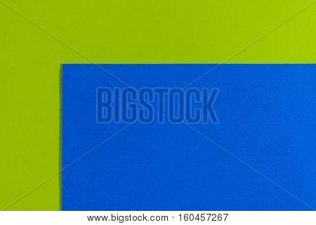 Eva foam ethylene vinyl acetate sponge plush blue surface on apple green smooth background
