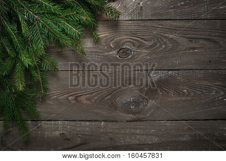 Christmas background. Fir tree branch pine cones at wooden table. Flat lay space for text.