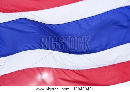 thai national flag flapping in the wind close-up detail