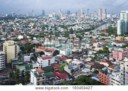 MANILA - July 6 2006: view over the Pasig river from Makati towards antipolo. Manila is the overcrowded capital of the Philippines and is located on the main island of Luzon.