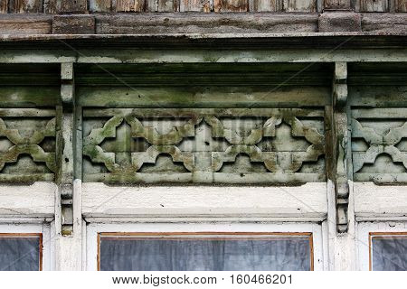 artsy decor trim and classic old wooden house. triangular patterns and wood texture brick color.