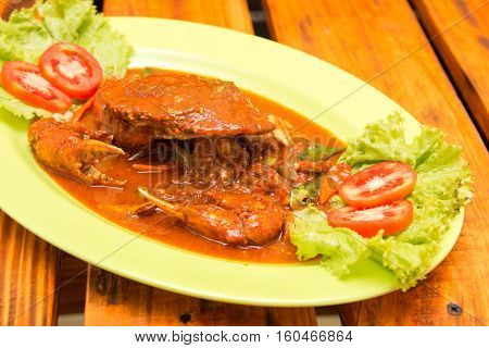 Special fried crab with Padang chili sauce with tomatoes slice and lettuce