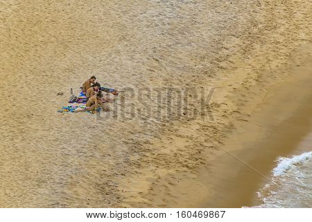 PIPA, BRAZIL, JANUARY - 2016 - Top view shot of young women at empty beach in Pipa Brazil