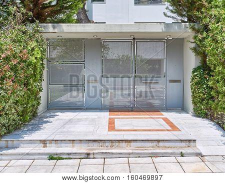 elegant modern house entrance with metallic door