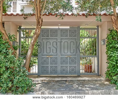 modern house entrance with metallic ornate door