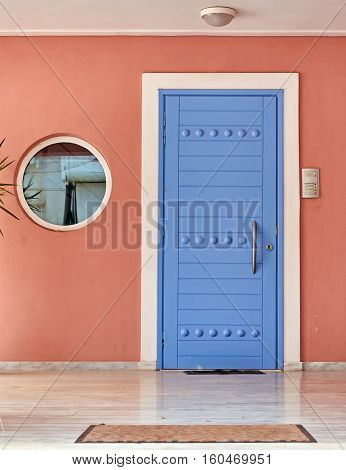 colorful modern house entrance with blue door