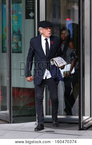 LONDON, UK, NOV 08, 2015: Ian McKellen attends the Andrew Marr show at the BBC studios in London picture taken from the street