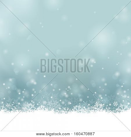 Merry Christmas - soft blurred winter background or card with blue, turquoise bokeh and snowflakes, copyspace for your text