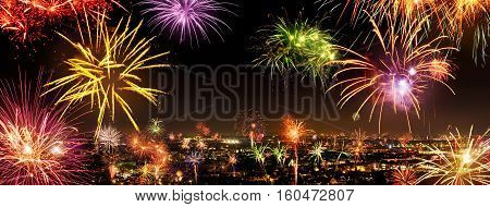 Whole city celebrating the New Year or a national event with lively fireworks copyspace on the night sky