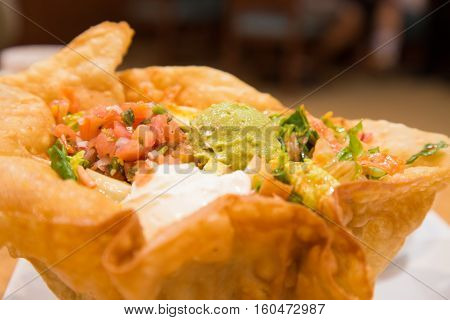 delicious fresh taco salad served in an edible tortilla bowl