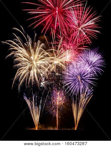 Gorgeous fireworks on black background ideal for New Year or other celebration events vertical format