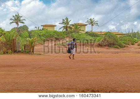 PIPA BRAZIL JANUARY - 2016 - Backpacker black man walking at tropical scene in Pipa Brazil