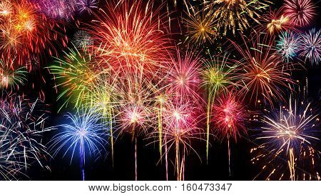 Lively multi-colored fireworks on black background ideal for New Year party or any celebration event