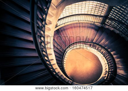 Staircase in spiral or swirl shape fibonacci golden ratio composition abstract or architecture concept dark vintage mysterious tone