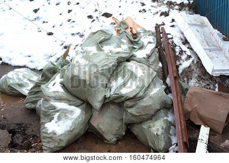 bags of garbage on the street. environmental pollution.