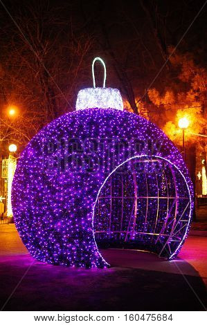 big gazebo in form of Christmas balls in winter park