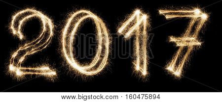 2017 New year font made from sparkler firework on black background. Two thousand seventeen numbers. Illuminated date figures, pattern for calendar
