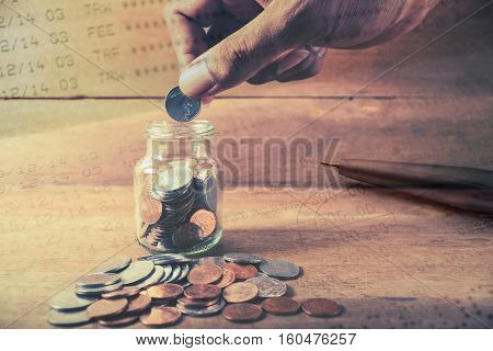 Double exposure hand with rows of coins with account banking for finance concept, Money and saving and finance concept