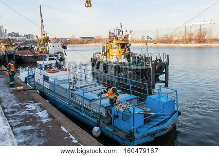 MOSCOW, RUSSIA - NOVEMBER 11, 2016: State Unitary Enterprise Mosvodostok performs recovery vessels on coastal winter parking. Ships Mosvodostok on the Moscow River.