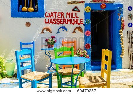 Kos island, Dodecanese, Greece - May 16, 2016: the interior of traditional Greek restaurant with colorful chairs.