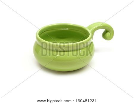 Single small clay empty green cocotte isolated on white front view closeup