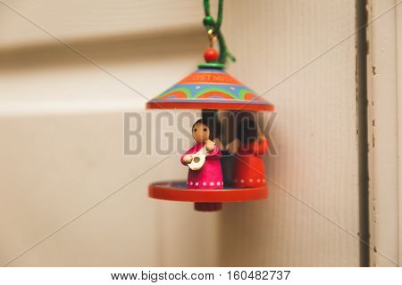 Hanging holiday musical themed ornament with mini figures