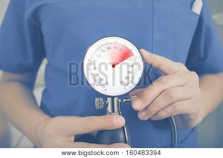 Medical concept with the doctor holding manometer.