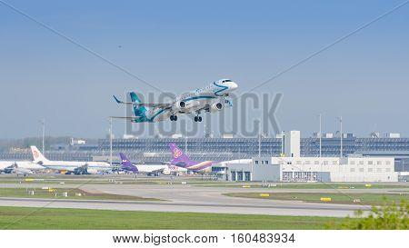Plane Embraer E-jet Of Air Dolomiti Airlines Gaining Altitude