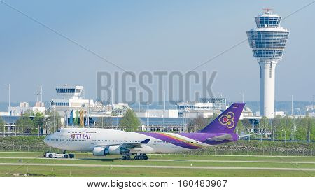 Jet Airliner Thai Airways International Airlines Taxiing On Pushback Tug