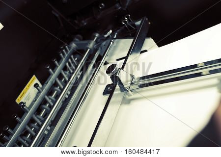 Paper in tray of printing machine. Macro photo