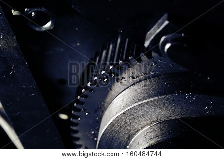 Flywheel with oil drops close-up. Black color