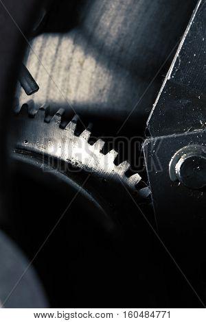 Mechanical background with gearwheel or flywheel of motor.