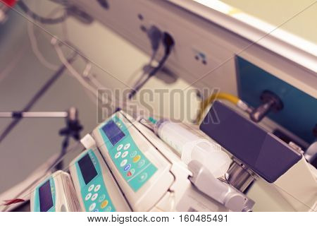 Syringe on the medical devices in ICU.