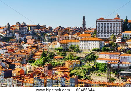 View Of The Historic Centre Of Porto. The Bell Tower Of Torre Dos Clerigos Is Visible On The Blue Sk
