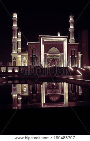 Night mosque with water reflection. Beautiful view