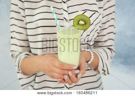 Woman holding kiwi milk shake