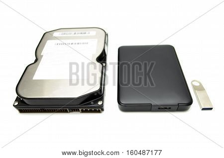storage devices hard drives and USB flash drive on a white background